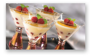 Elegant Vanilla Pudding with Raspberries and Cracked Sugar Topping